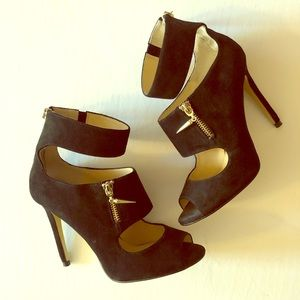 Enzo Angiolini cut-out pumps in black suede.